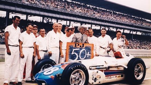 Parnelli Jones with car owner J.C. Agajanian and crew after breaking the 150 mile per hour barrier during qualifying at the Indianapolis Motor Speedway in 1962.