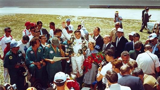 1965 Indianapolis 500 winner Jim Clark celebrating in victory lane with crew.