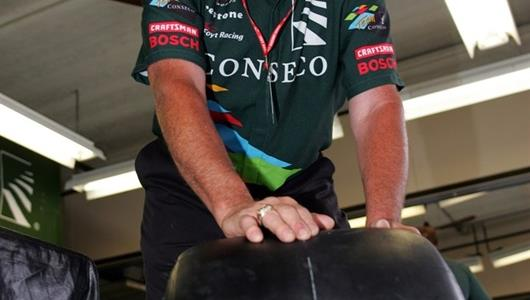 A crewman for Conseco/A.J. Foyt Racing rolls out a tire at the Indianapolis Motor Speedway.