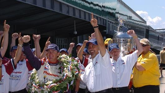 Buddy Rice, left, and Rahal-Letterman Racing co-owner Bobby Rahal celebrate with the team.