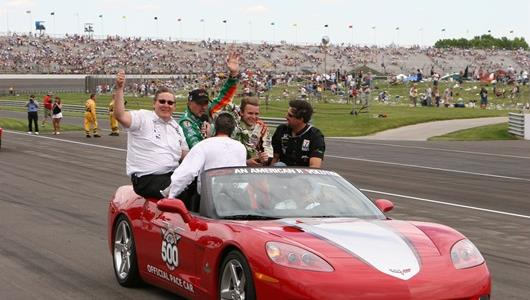 2005 Indianapolis 500 champ Dan Wheldon takes a victory lap with Andretti Green Racing co-owners Kevin Savoree, Kim Green and Micheal Andretti after the 89th running of the Indianpolis 500 at the Indianpolis Motor Speedway.
