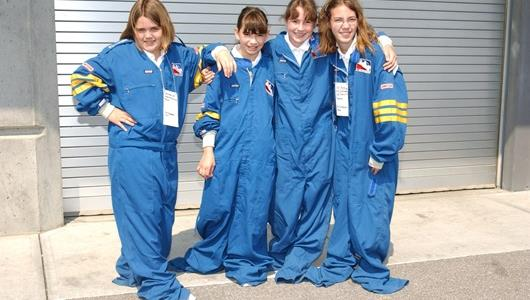 Young race fans dressed in firesuits during Rookie Orientation at the Indianapolis Motor Speedway.