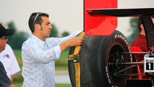 Sam Hornish Jr. secures the Penkse Racing show car on a flatbed.