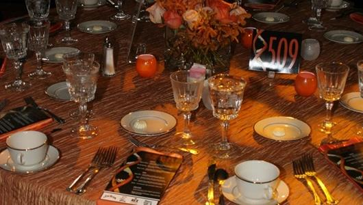 Fancy affair table settings for 500 Victory Banquet.