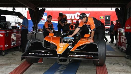 The car of Dario Franchitti gets rolled onto the tech pad at Richmond International Raceway.