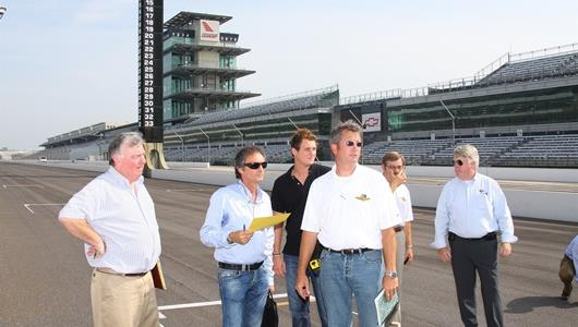 FIM Safety Director Claude Danis, left, 1982 500cc World Champion Franco Uncini, center,  IMS director of engineering and construction, Kevin Forbes, and FIM Race Director Paul Butler, far right, surveyed progress of the construction of the IMS motorcycle road course during a visit Aug. 22-23