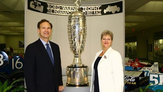 U.S. Supreme Court Justice Samuel Alito, left, and his wife, Martha-Ann, next to the Borg-Warner Trophy.