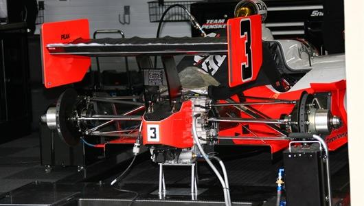 Helio Castroneves' car in the garage area before the start of day 1 practice at Indianapolis Motor Speedway.