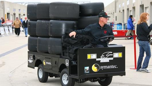 IndyCar Series teammembers move their gear to trackside to prepare for fast Friday practice.