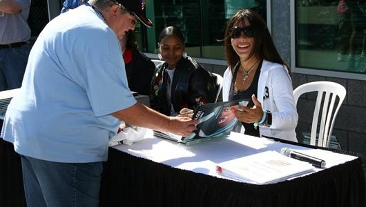 Milka Duno signs autographs during Community Day at the Indianapolis Motor Speedway.