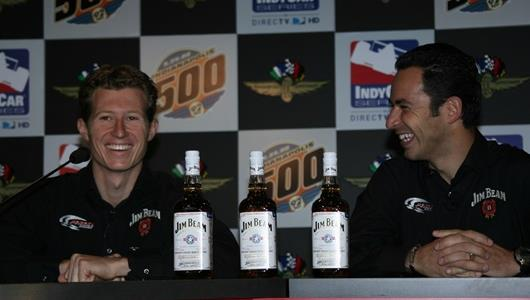 Team Penske teammates Ryan Briscoe and Helio Castroneves, laugh it up during a Jim Beam press conference at Indianapolis Motor Speedway.
