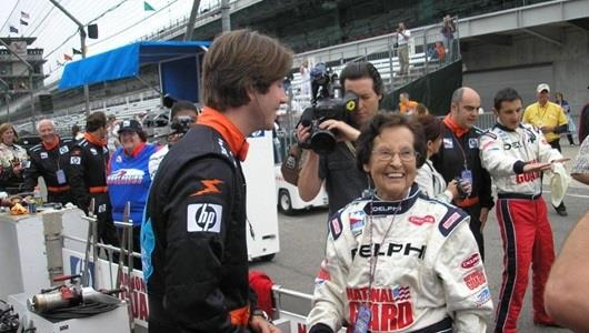 96-year-old Muncie resident Edith Pittenger talks with Arie Luyendyk Jr. before he takes her out on the track for a ride in the two-seater.