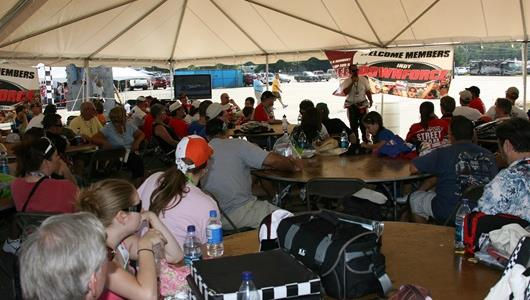 Jack Arute speaks with members of the Indy Downforce Club on race day at Richmond.
