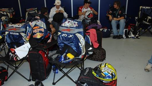 Young riders prepare their gear for a day of testing.