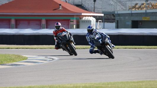William Costes, left, and Wataru Yoshikawa guide their Yamaha MotoGP bikes through the infield section of the IMS road course.