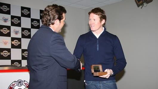 IMS President and Chief Operating Officer Joie Chitwood presents the Champion of Champions winner's ring to 2008 Indianapolis 500 winner Scott Dixon.