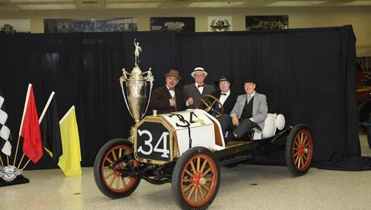 Actors dressed like the four founders of the Indianapolis Motor Speedway -- Frank Wheeler, James Allison, Carl Fisher and Arthur Newby -- posed in a 1909 Buick Model 16B with the Wheeler-Schebler Trophy during Centennial Era festivities March 20 at the IMS Hall of Fame Museum.