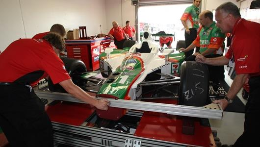 The No. 11 7-Eleven car of Tony Kanaan goes through technical inspection.