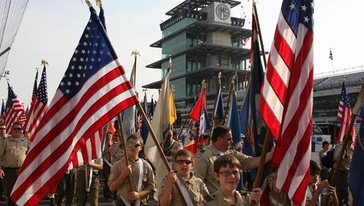 Boy Scout troops carries the stars and stripes in the pre-race parade.