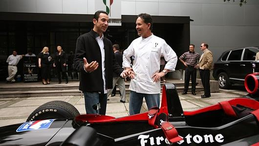 Helio Castroneves, left, explains the ins and outs of an IndyCar to chef Stephan Pyles on May 11 in Dallas.