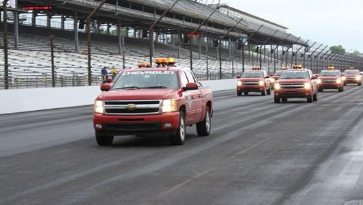 Chevrolet trucks work hard to dry the track so cars are able to take the track for the third day of qualifying.