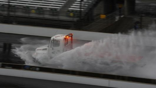 IMS fire safety crews attempt to dry the track following heavy morning downpours.