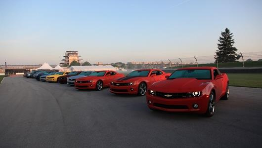 Brand-new Chevrolet products are lined up on the IMS road course, ready for customer test drives.