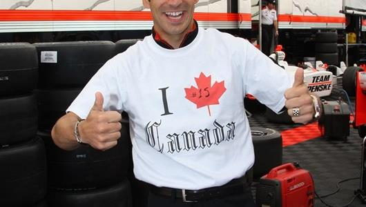 Helio Castroneves shows his support for Canada.