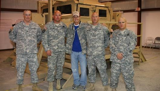 American MotoGP star Colin Edwards (center) visits with United States Army personnel at Camp Atterbury near Edinburgh, Ind.