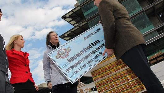 Mari Hulman-George presents a check to Gleaners Food Bank