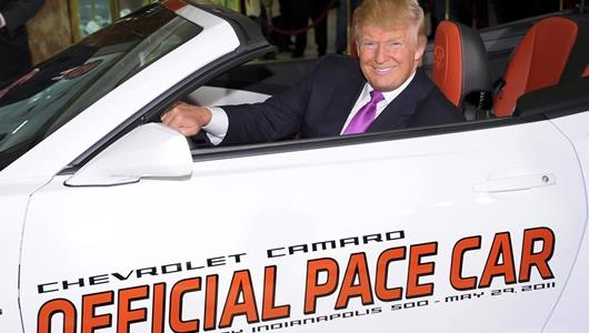 Donald Trump behind the driver's seat of the 2011 Indianapolis 500 Pace Car