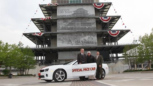 Jeff Belskus, A.J. Foyt), and Sam Coomes in front of the Pagoda.
