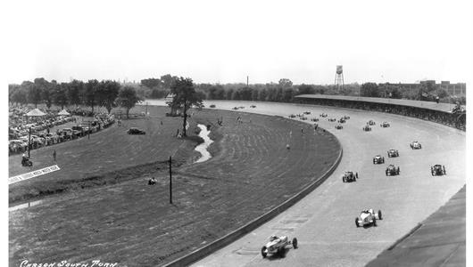 Cars race through the south turn