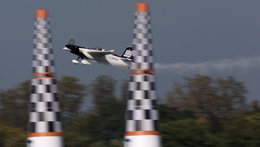 Michael Goulian crosses through the finish gate during practice for the Red Bull Air Race