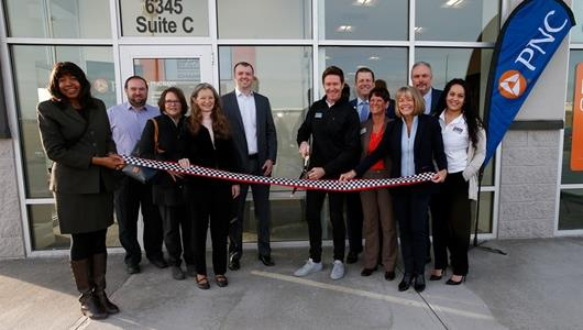 Scott Dixon alongside PNC executive team and leaders from the Town of Speedway as he cuts the ribbon for the new branch.