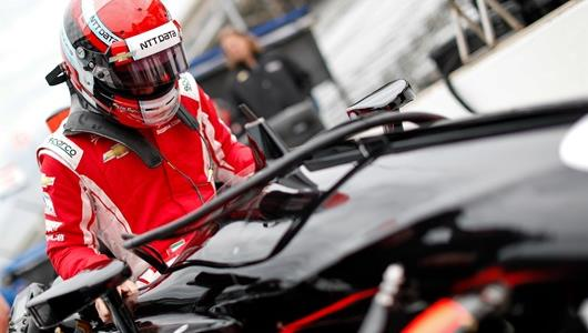 Ed Jones getting into his No. 20 Indy car.