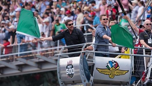 Christian Bale and Matt Damon wave the green flag
