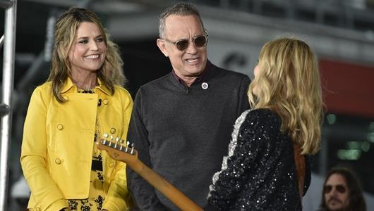 'TODAY Show' special guest Tom Hanks shares a laugh with host Savannah Guthrie and live performing artist Sheryl Crow at the Indianapolis Motor Speedway