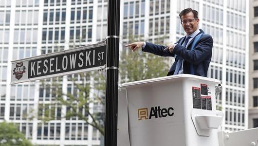 IMS president Doug Boles installs Brad Keselowski street sign.