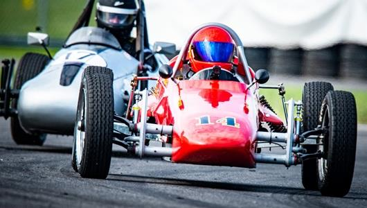 Vintage race cars take on the IMS road course on Sunday of the Brickyard Vintage Racing Invitational