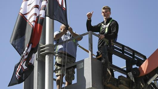 Josef Newgarden hoisting his flag high on Gate 1