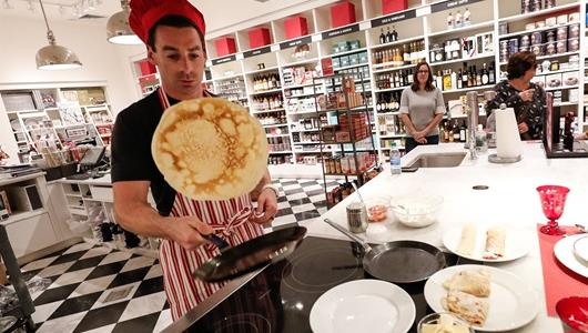 Simon Pagenaud shows off his pancake flipping skills at Santa Simon's Soiree at The Fashion Mall at Keystone