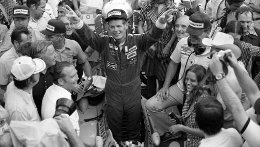 Bobby Unser celebrates in Victory Circle after winning the 1975 Indianapolis 500