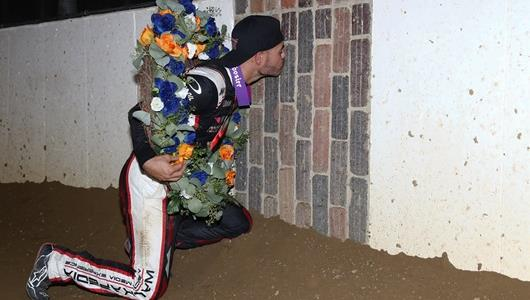 Kyle Larson kisses the bricks at The Dirt Track at IMS after winning the Driven2SaveLives BC39 Powered by NOS Energy Drink Thursday, Aug. 19.